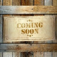 Stamp Coming Soon label old wooden box
